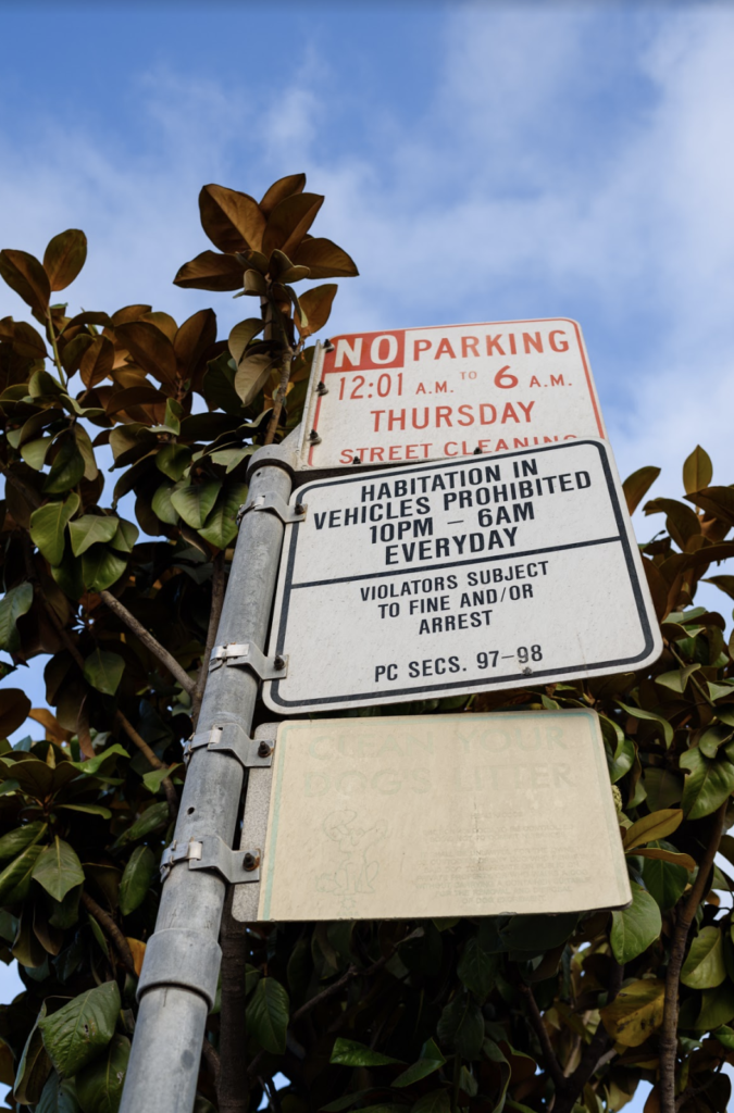 "A posted sign prohibits ""habitation in vehicles"" between 10pm and 6am everyday, and says ""violators subject to fine and/or arrest"""