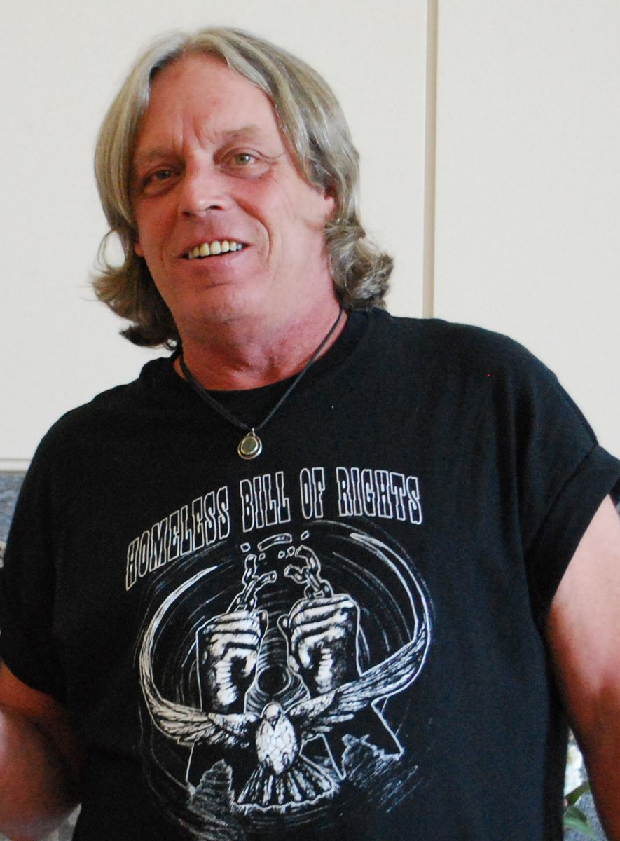"Man with shoulder-length hair wearing a shirt that read ""Homeless Bill of Rights"""
