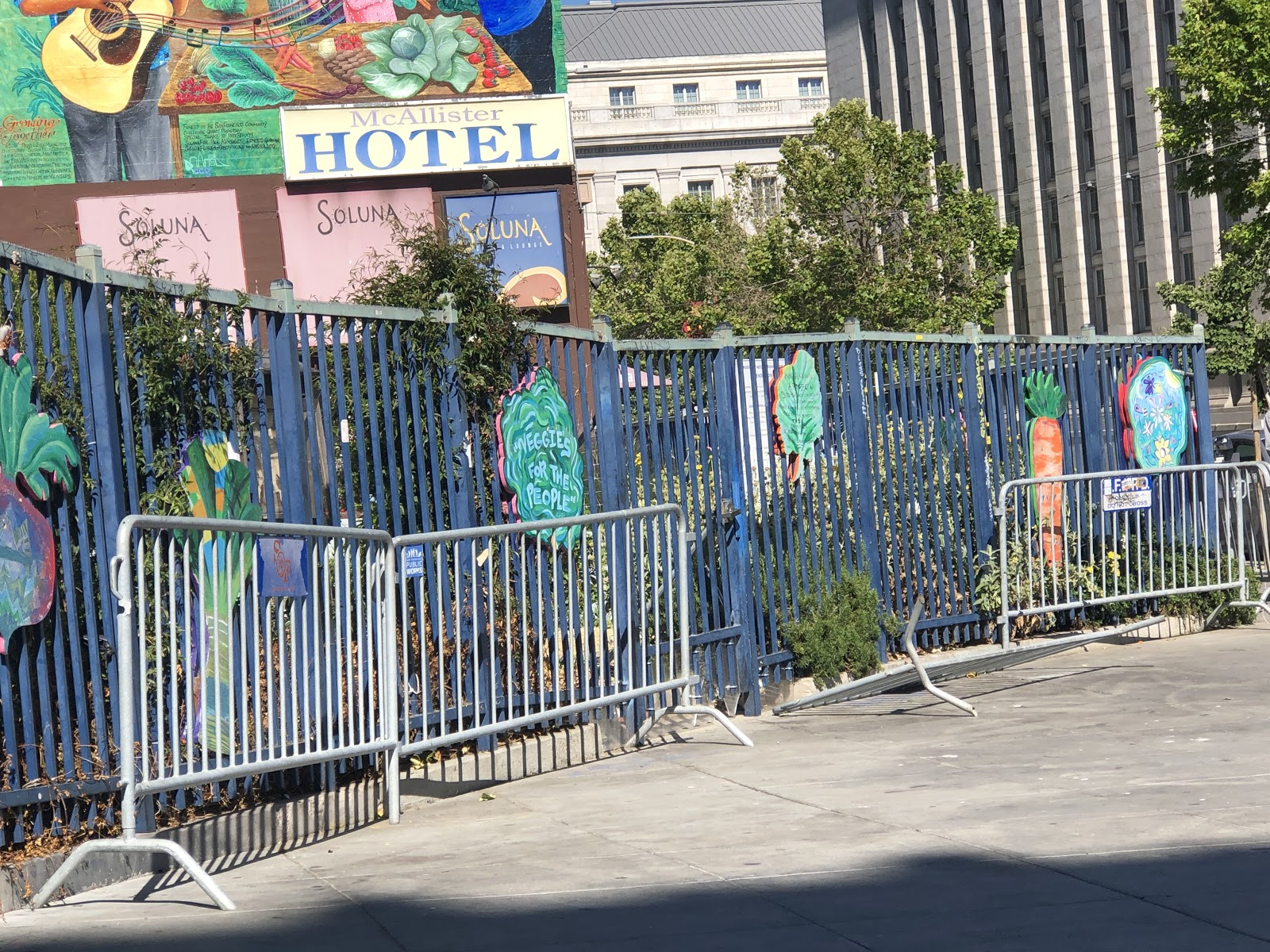 barricades around the Tenderloin community garden